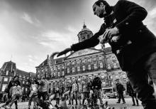 Street Photography Amsterdam pigeon man